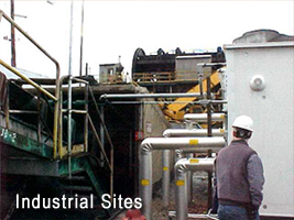 Exterior of Industrial Site with Worker
