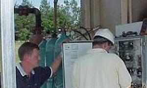 Men adjusting Precision Gas Monitoring System